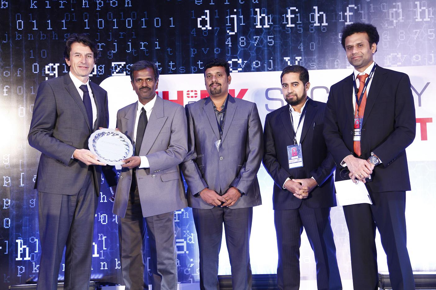 Sendil Kumar, AVP - IT Infrastructure and Datacenter,Shriram Group (second from left) receiving the award from Patrice Perche, Senior Vice President, International Sales and Support, Fortinet.