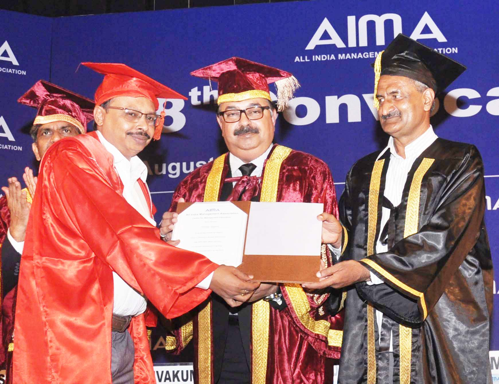 Alekhya Talapatra receiving Doctorate from Sudhir Vasudeva, Chief Managing Director, ONGC