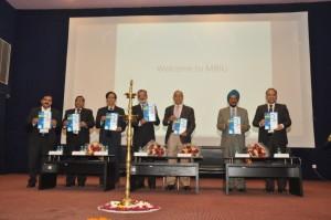 ICROIT-2014 held at MRIU_ Delegates unveiling the souvenir