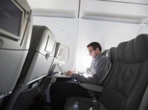 man using laptop on plane reuters