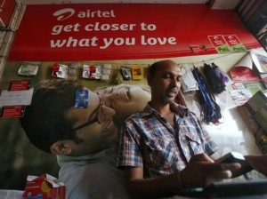 man using mobile in airtel store