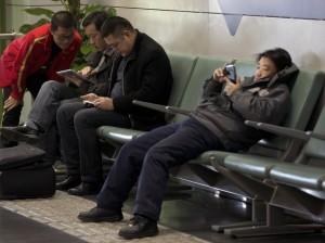 chinese men using mobiles ap
