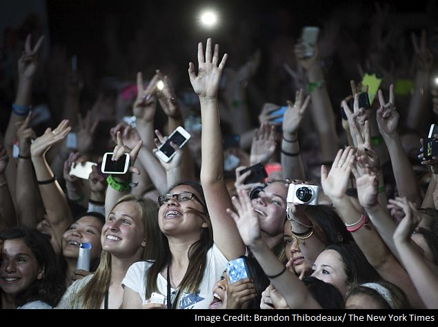 Girls in the crowd cheer before a performance at a DigiTour show in Dallas.