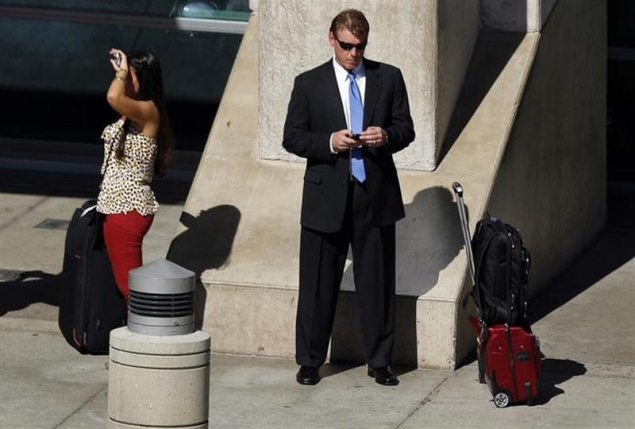 man_looking_at_his_mobile-_reuters
