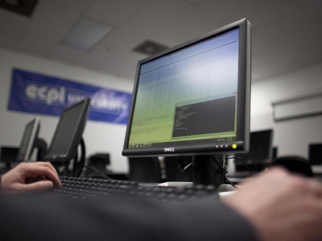 man_working_on_dell_pc_reuters