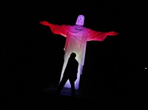 The statue of Christ the Redeemer is lit up in Canada's official colours, red and white, for Canada Day in Rio de Janeiro
