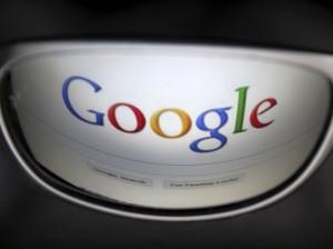 google_logo_on_glass_reuters
