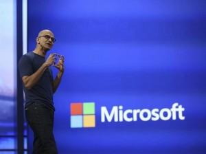 "Microsoft CEO Satya Nadella gestured during his keynote address at the company's  ""build"" conference in San Francisco"