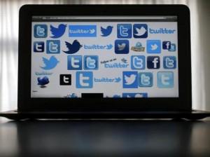twitter multiple logos on laptop