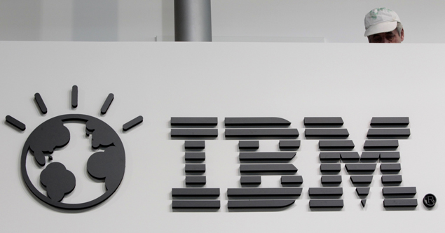 File photo shows a worker behind a logo at the IBM stand on the CeBIT computer fair in Hanover