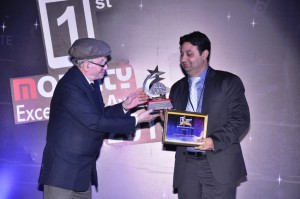 Mr. Harsh Vardhan, Head - Marketing, Jivi Mobiles receiving the 1st Mobility Excellence Award for best feature phone category.