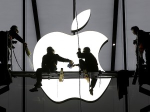 workers apple logo building