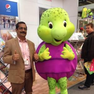 Manish Rajoria Director Aadarsh Pvt Ltd with Purple Turtle Mascot