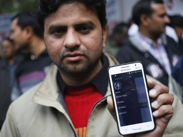 indian taxi driver with uber app
