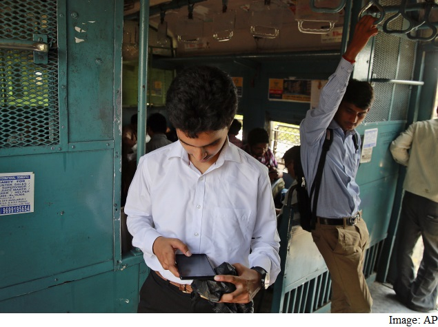 man checking mobile on train india
