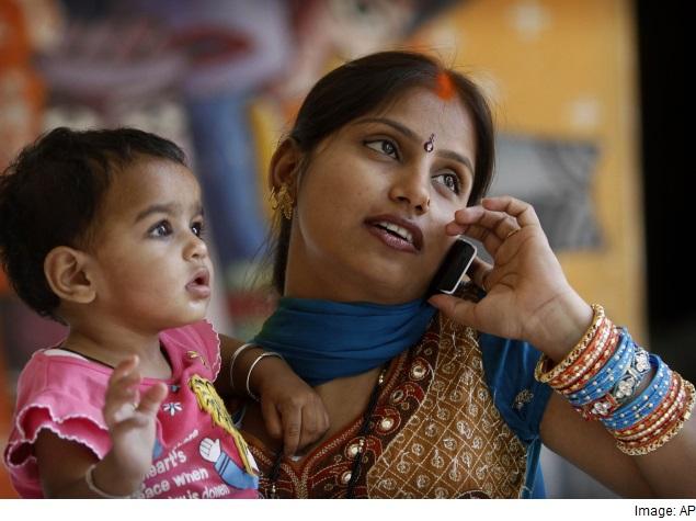 women talking on mobile