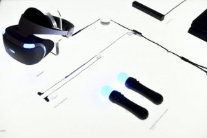 Components of Sony's PlayStation VR, including Playstation Move motion controllers at bottom right, are displayed during an event in San Francisco