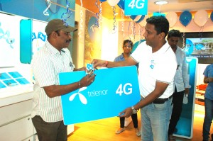 Shrinath Kotian, Circle Business Head-AP&TS, Telenor India (on right) ha...
